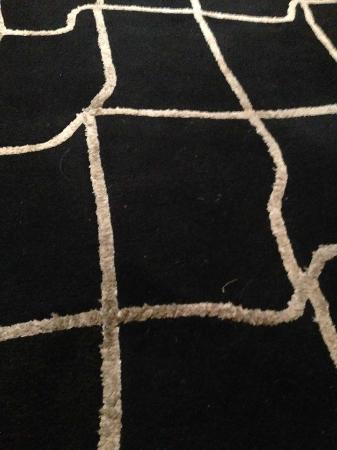 Falstone Barns: very dirty rug on bedroom floor