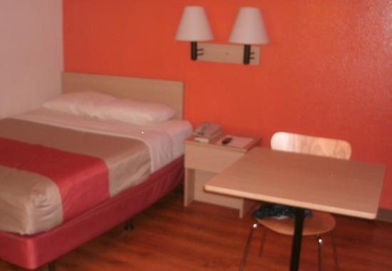 Motel 6 Brattleboro: Bed, nightstand, table, chair, floor -- not much more
