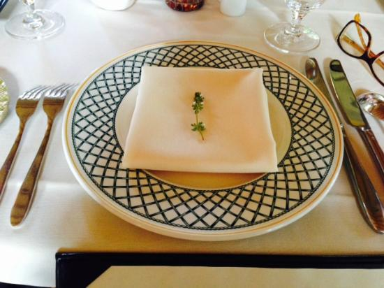 Suzanne Fine Regional Cuisine: The lovely china and an herb touch. They invite you to see the herb garden.