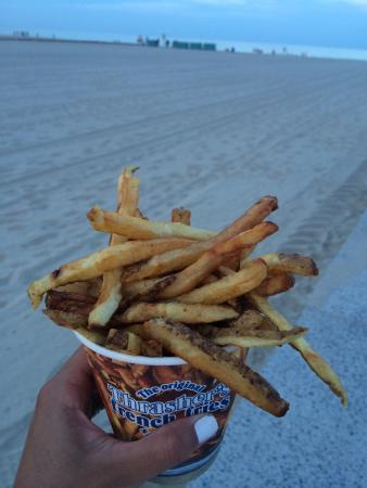 Thrasher's French Fries: The best fries on Ocean City!! Your choice of topping it with salt and vinegar. Must try! Delici