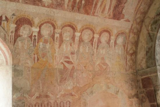 Kempley, UK: A portion of a fresco showing the Apostles.