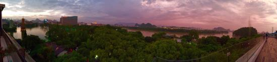 """Vienna Hotel Guilin Shanghai Road: View of Li River from the rooftop at the """"magic hour"""" of the day. Fantastic!"""