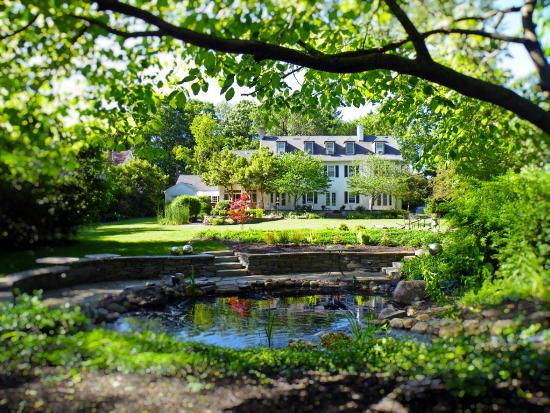 10 Fitch Luxurious Romantic Inn: Summer view from the back yard overlooking the large koi pond