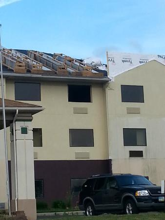 La Quinta Inn & Suites Fairborn Wright-Patterson: Exterior of Gutted out side of hotel