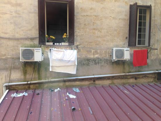 "Grand Hotel Via Veneto: Our ""courtyard"" view - really a gross alley with people's dirty laundry drying"