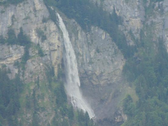 Hotel Alpenrose: Waterfall coming into town.