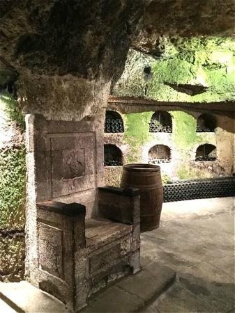 Caves Louis de Grenelle : Room with carved throne and very old wines