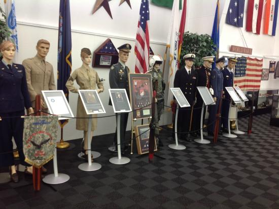 Bird Aviation Museum & Invention Cente: Display of uniforms of the various branches of military