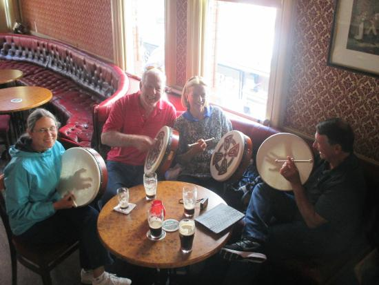 The Irish Folk Experience: Our group learning the bodhran