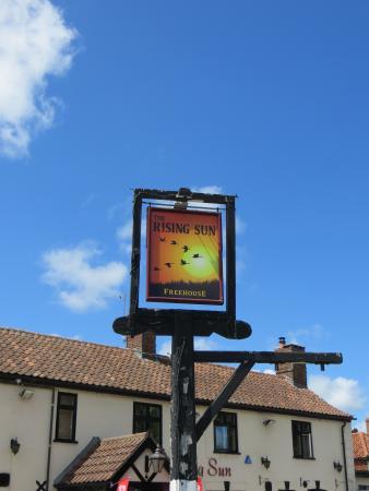 The Rising Sun: sign post