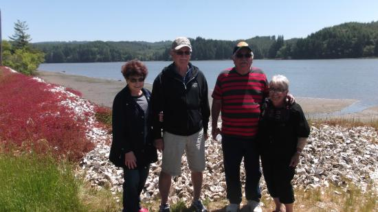 Oregon Oyster Farms: The folks standing on the oyster shells outside the farm..