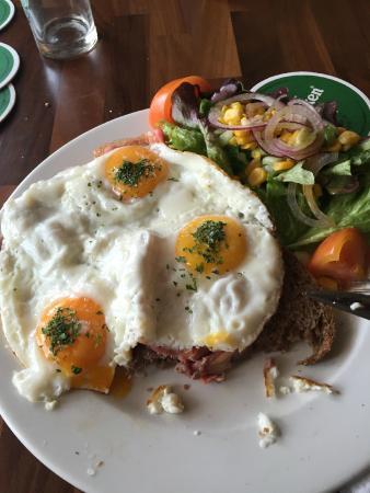 Main dish: eggs, bacon, toast and salad.