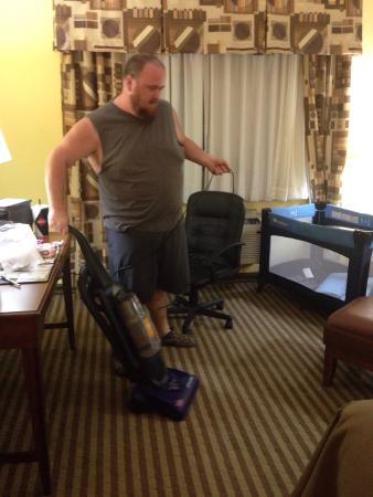 Comfort Inn & Suites Byram: Me vacuuming the hotel's mess.