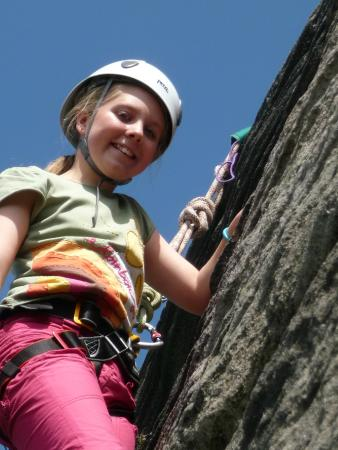 Ipstones, UK: A happy climber with Rock Climbing Peak District on a Keen Youth event at Birchen Edge