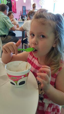 Sweet Frog Frozen Yogurt: Enjoying her frozen yogurt