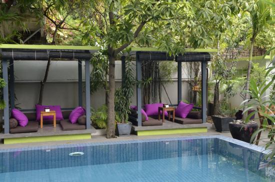 seats near the swimming pool