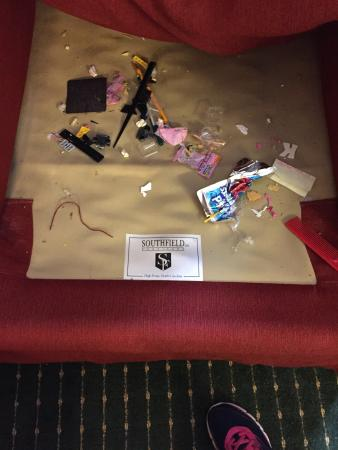 Decatur Extended Stay Hotel : Trash in couch upon arrival to room.