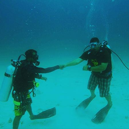 Dive Club Maldives: Underwater handshake: Only people who does the handshake underwater will understand it.