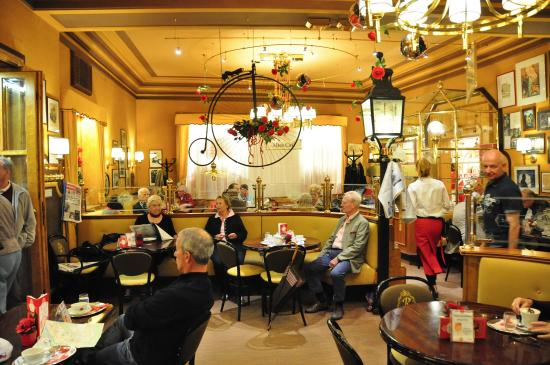 """AVALON Hotel Bad Reichenhall: Charming tea and cake shop, old town, red awnings; named """"Red something..."""""""