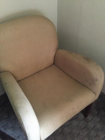 Quality Inn & Suites Bensalem : Stained Furniture. Both Chairs.