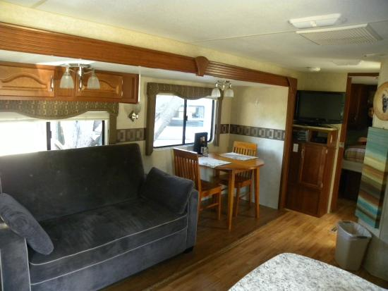 Manchester Beach KOA: Sofa and table in rental RV