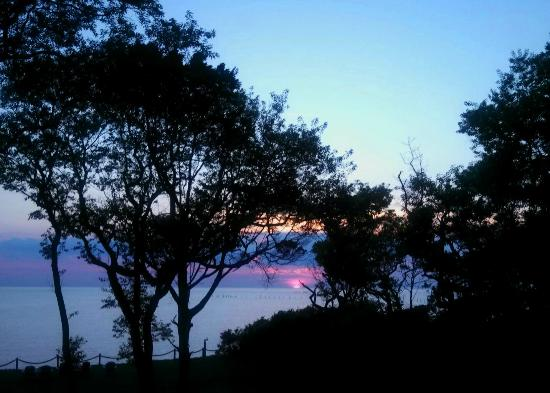 The Baywood Bed and Breakfast: Sunset over the bay as seen from the Lighthouse Room balcony