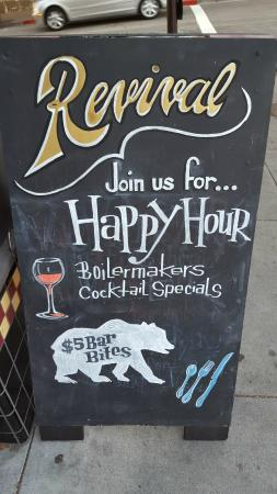 Revival Bar+Kitchen: Happy Hour posted on the side walk Saturday 6/20 Evening