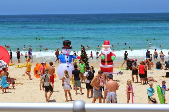is that a snowman a christmas tree and a santa i see on bondi beach