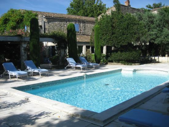 La Maison du Paradou: View across the pool back to the main house.