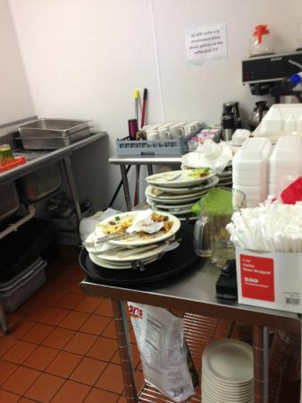 Spaghetti Jim's Market & Cafe: Dirty dishes piled up in the area next to our room. Wait staff didn't even come clean them, we d