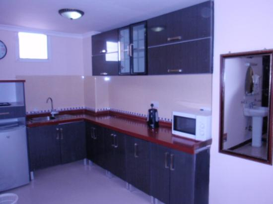 Urban Rose Hotel and Apartment: Room in kitchen area very well kitted out, included is a fridge and kettle with bottle water eac
