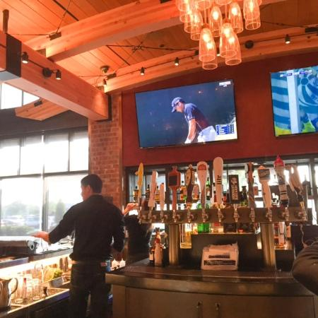 Wood Ranch BBQ & Grill: Bar with the requisite TVs - Bar With The Requisite TVs - Picture Of Wood Ranch BBQ & Grill
