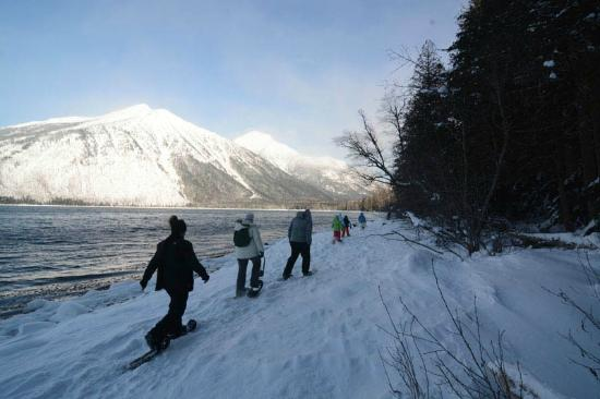 Columbia Falls, MT: Snowshoeing the frozen shores of Lake McDonald.