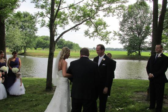 Marshall, IL: The attached picture is showing the wedding with the lake in the background.