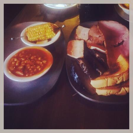 Clark's Outpost Bar-B-Q: Smokey beans, fried corn on the cob, smoked brisket, ham & turkey - more than enough to share -