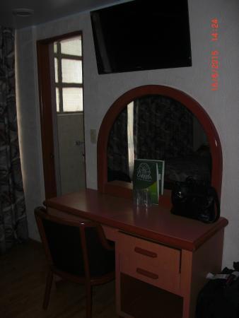 Hotel Diligencias: Parte de la habitación