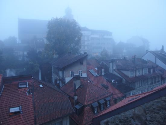 Hotel du Faucon Fribourg: view over the roofs of the old town on a misty autumn morning.