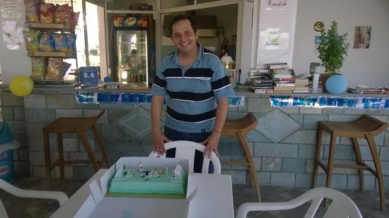 Nikos II Apartments: The football fanatic, (George) and his birthday cake!! (nice one Kath!)
