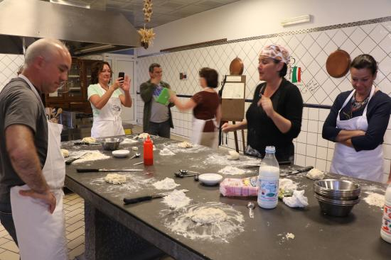 Cooking School La Cucina del Gusto by Chef Carmen: Making pizza dough with Chef Carmen.