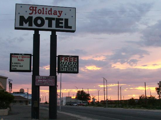 Holiday Motel sign at sunset