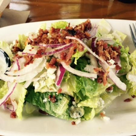 The Grill House: WEDGE SALAD with red onion, bacon, bleu cheese