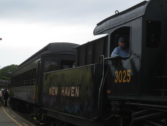 Essex, CT: The engine has just been connected to the passenger cars in preparation for the next ride.