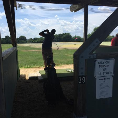 East Potomac Golf Course Golfer Hits A Jumbo Bucket At The Driving Range