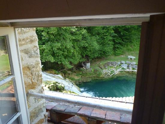 Castel Damandre: View of water fall and pool from bathroom (room#6)