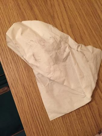 Tilstone Guest House: Tissue after wiping the shelf by the bed