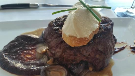 Revolution - Durham: Filet w/Mushroom Sauce and Blue Cheese - It literally melted in my mouth. Best steak I've ever h