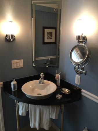 bathroom sink very small and room is dim picture of the portofino hotel marina a noble. Black Bedroom Furniture Sets. Home Design Ideas