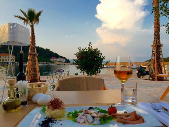 sea view, fish plate & glass of wine