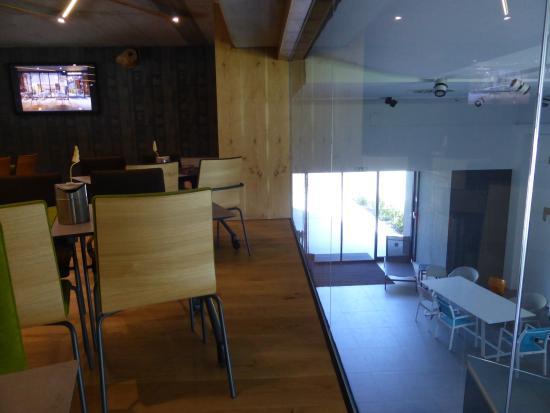 Hotel Nox: Breakfast Area Overlooking High End Furniture Store