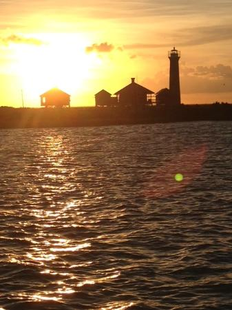 Dolphin Encounters: sunset over the lighthouse
